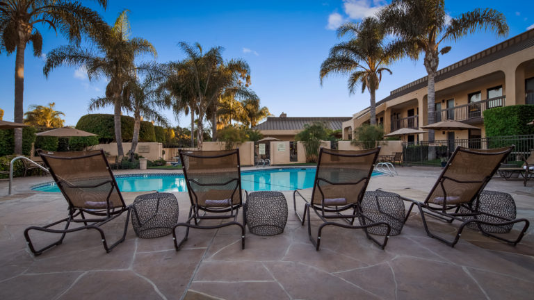Pool with lounge chairs at the Best Western Plus South Coast Inn Goleta
