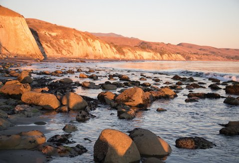 An image of Gaviota, with rippling water and a preponderance of rocks.