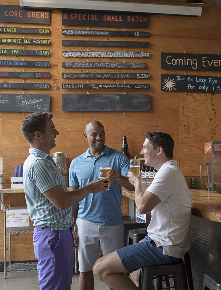 Guys drinking beers at M. Special Brewing Company