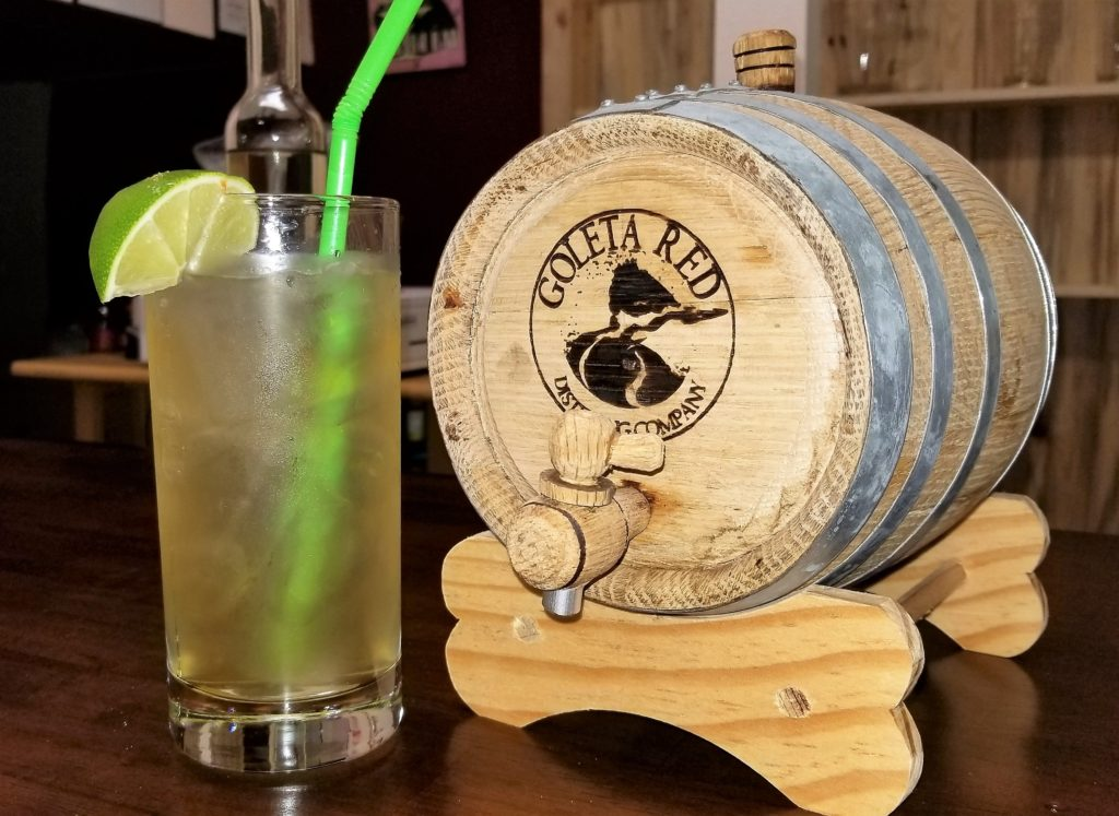 Image of a rum drink and a small keg from Goleta Red Distilling Company