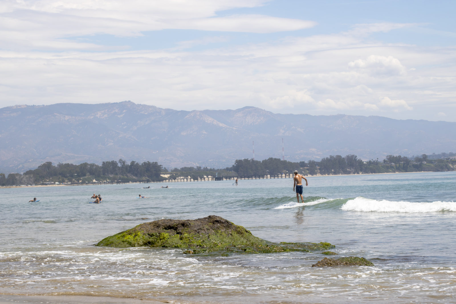 Man Surfing Campus Point in Goleta