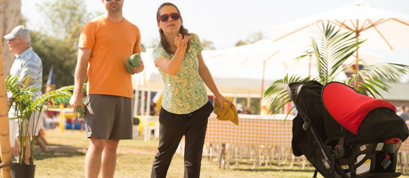 There's fun to be had by everyone at the Goleta Lemon Festival—like this man and woman who are playing cornhole.