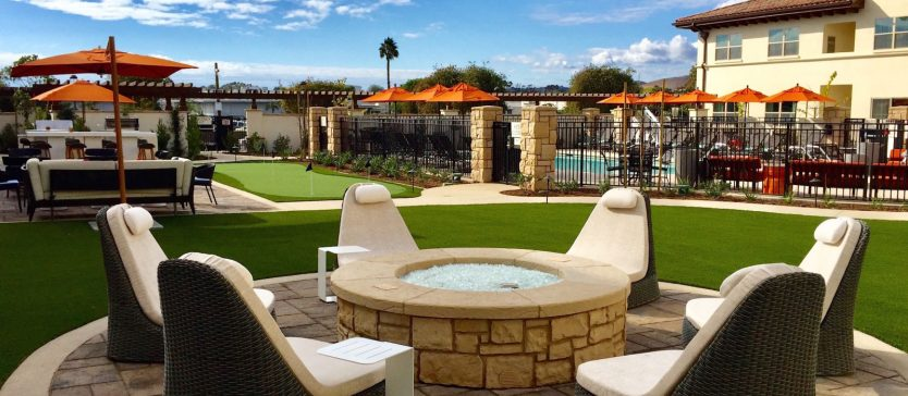 Vibrant, classy and comfortable, the Residence Inn is the perfect pit-stop for indulgent sun-seekers. Goleta's great weather year round make it a perfect travel destination. Pictured here: luxurious lounge chairs surrounding a fire pit in the day time.