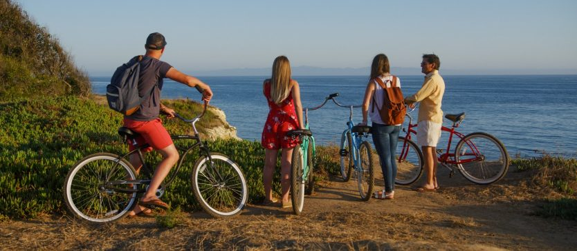 A group of cyclists ride along Goleta's beautiful beachside coast.
